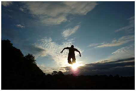 A photo of a boy leaping for joy at Oatfield, Mull of Kintyre
